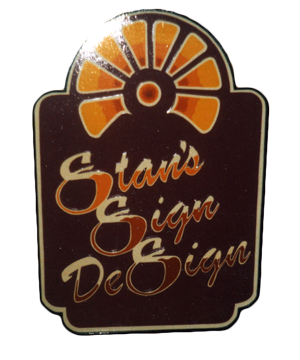 Old wooden sign with Stan's Sign Design Logo