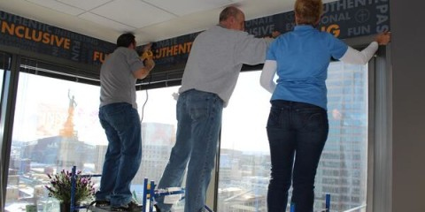 Stan's Sign Design installing wall wrap at TechPoint, Indianapolis